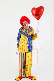 clown balloon sad clown with a heart balloon stock photos freeimages