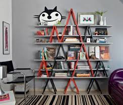 Small Red Bookcase Cute Bookcase With Black And Red Pole With Vased Palnt And Chair