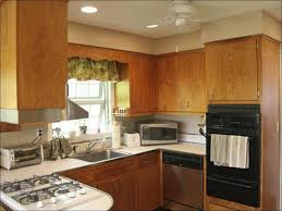 Can You Paint Over Kitchen Cabinets by Painting Over Stained Cabinets In The Kitchen Inspirations Also