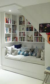 wall shelves and seating spot under stairs creative interior