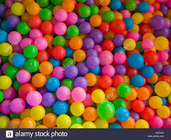 lots of colored plastic balls in a playground pool stock