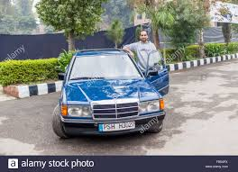 roll royce pakistan pakistan car owner is taking portrait with classic car show in