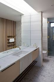 small ceramic tile around rectangle wall mirror two round sinks