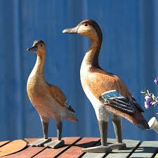 a of duck carved wooden ornaments mediterranean home