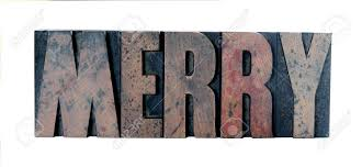 ink stained wood letters spell out the word merry in all
