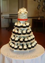 red black and white wedding cake and cupcake tower rose bakes
