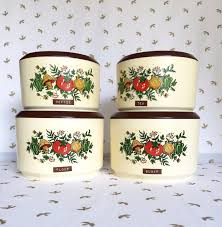 4 vintage kitchen canisters with retro graphics by hautelaudubon