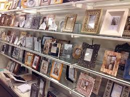 a frames for sale photo frames for sale in a store editorial image image of shelves