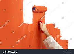 hand paint roller covered bright orange stock photo 83988484