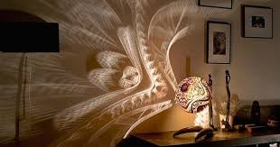 these lamps create incredible art on the walls surrounding them