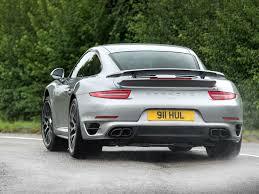grey porsche 911 turbo aston martin v12 vantage s vs porsche 911 turbo s pistonheads