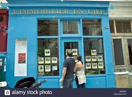 paris france couple window shopping for apartments looking in