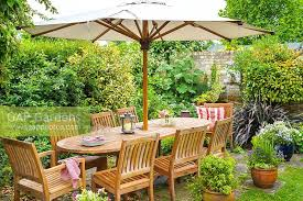 Outdoor Dining Area With No Chairs Gap Gardens Outdoor Dining Area In Secluded Corner Of Family