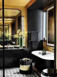 art deco bathroom with black vanity and tub with flower vase and