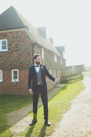 moss bros groom suit waistcoat bow tie relaxed country spring farm