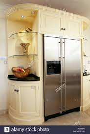 cream kitchen unit with built in stainless steel american fridge