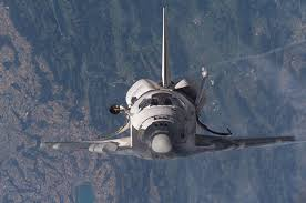 nasa space pictures shuttle discovery over switzerland epfl