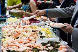 photo of cooked shrimp and crab legs served at a wedding during