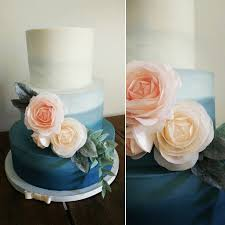 peach ombre wedding cake ombre navy blue wedding cake with blush and peach wafer paper roses