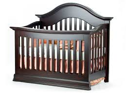 decorating black wooden crib with orange bedding by munire crib