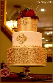wedding cake gold rich golden monogrammed scrolled wedding cake by the pastry studio