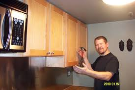 install cabinets like a pro the family handyman kitchen cabinets repair voicesofimani com