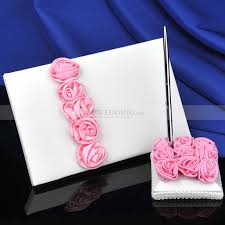 quinceanera guest book white satin guest book and pen set with pink rosettes