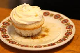 vegan pineapple upside down cupcakes with passion fruit cream