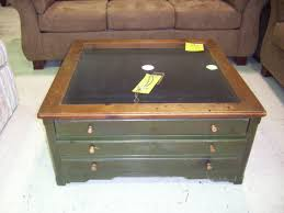 pretty glass top square coffee table with wooden pedestal coffee