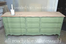how to whitewash brown cabinets how to whitewash wood furniture salvaged inspirations
