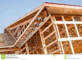 framing new wooden building structure construction stock photo