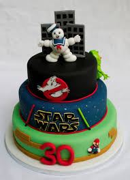 1980s theme birthday cake with ghostbusters star wars and mario