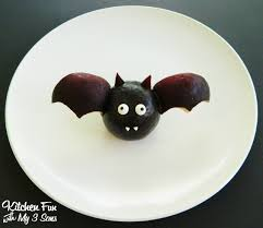 halloween fruit bat made with plums from kitchenfunwithmy3sons com