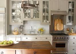 grey or putty cabinets on cream colored walls backsplash cream or