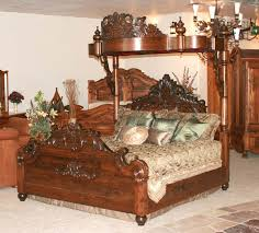 antique canopy bed with wood bed frame and pillows and chandelier