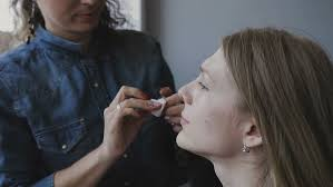 professional makeup and hair stylist professional make up artist and hair stylist working with girl