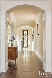 transitional neutral upstairs hallway luxe halls stairs