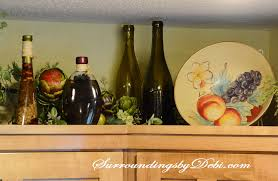 painting above kitchen cabinets adding interest to kitchen cabinets