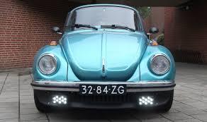 blue volkswagen beetle vintage daytime running lights drl in classic fog lights on a vw beetle