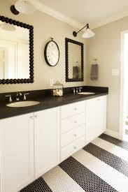 young boys bathroom with striped penny dot tiles and honed black