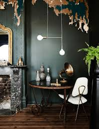 bronze accents and the white light fixture with the white chair