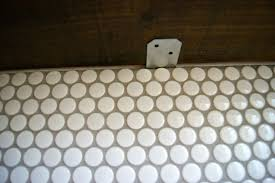 remodelaholic tips for installing penny tile backsplash diy penny tile backsplash install