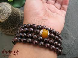 amber bead bracelet images Garnet wrap bracelet or necklace mala with tibetan amber guru bead jpg