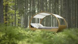 reverse tracking shot of a canopy swing bed in a forest stock