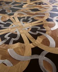 wood floor mosaic with steel and inserts by parchettificio