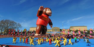family at philly s thanksgiving day parade disney characters