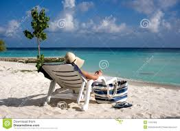 Beach Lounger Women Sitting On The Sun Lounger On The Beach Royalty Free Stock
