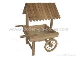 Wooden Wheelbarrow Planter by Wood Garden Wagons Wagon Planters Wooden Garden Wagon Wooden