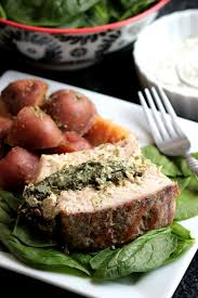 slow cooker ranch stuffed pork loin with red skinned potatoes