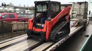 unloading our kubota svl 95 2s ctl at skidsteersolutions com youtube